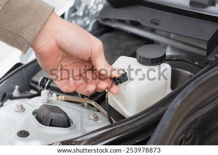 Man checking the engine of his car close up