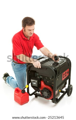 Man checking the fluid levels on his gas powered electricity generator.  Ready for a disaster. - stock photo