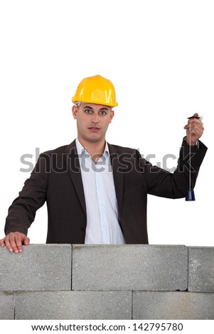 Man checking wall is level - stock photo
