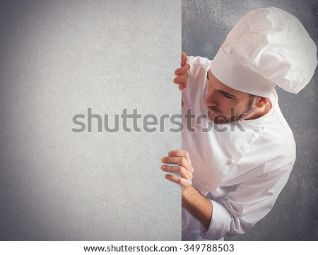 Man chef looks at a big billboard