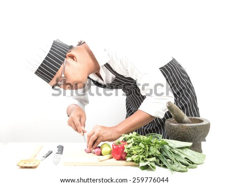 Man chef sliced onion, Isolated white background - stock photo