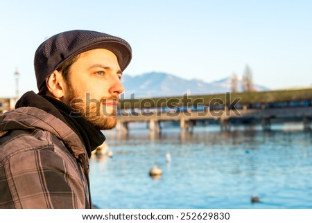 Man chilling out in Lucern, Switzerland. - stock photo