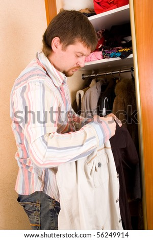 man chooses clothes