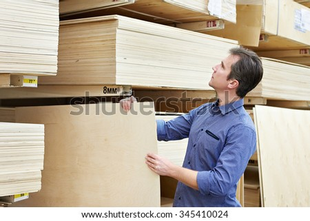 Man chooses plywood for the construction of the store