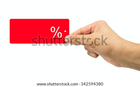 Man choosing clothes holding discount red label with percent sign in hand with sale concept - stock photo