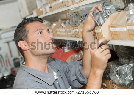Man choosing parts from stores - stock photo