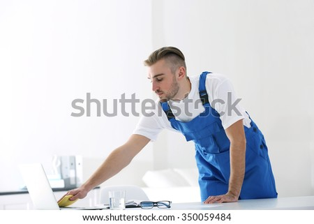 Man cleaner cleaning in office - stock photo