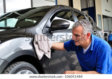 Man cleaning a car. - stock photo