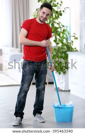 Man cleaning floor indoors - stock photo