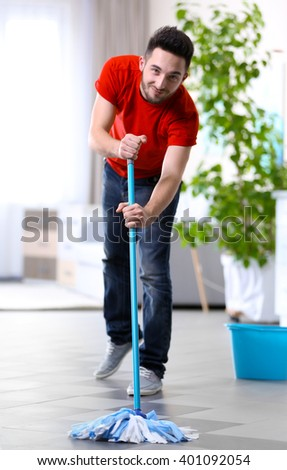 Man cleaning floor indoors