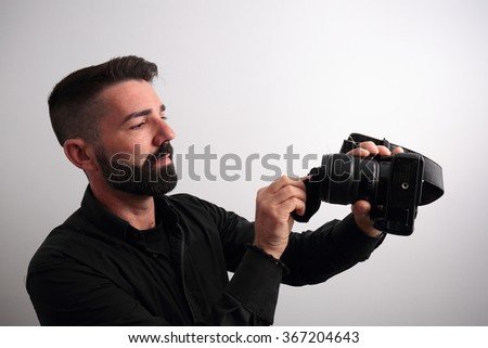 Man cleaning the camera lens
