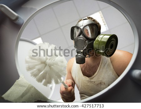 Man cleaning the toilet bowl