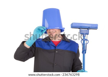 Man cleaning with mop and bucket on head. Isolated on a white background.