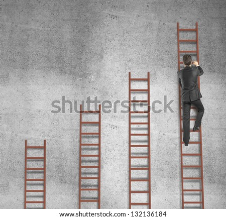 man climbing on ladder and concrete wall - stock photo