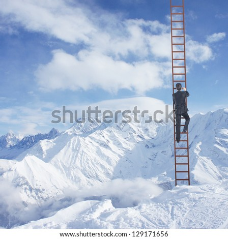 man climbing on ladder and mountains