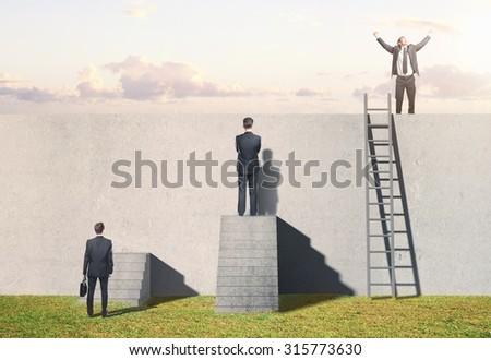 man climbing on ladder on wall - stock photo
