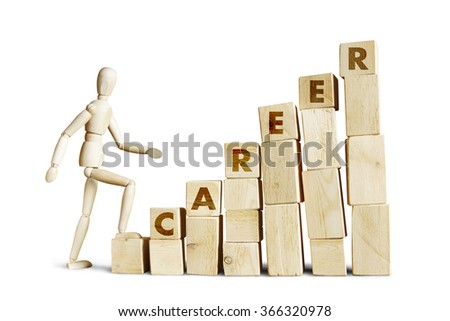 Man climbing up the career ladder. Abstract image with a wooden puppet - stock photo