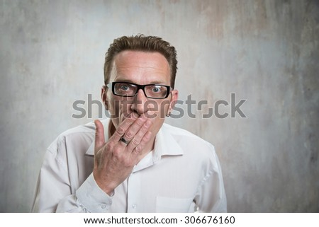 man close his mouth by hand. Concept of suppression and censorship - stock photo