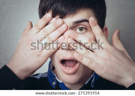 man closed one eye but second hand spies - stock photo