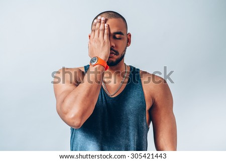 man closes his eyes with his hands