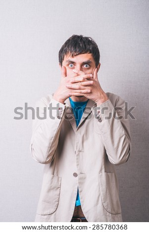 man closes his mouth - stock photo