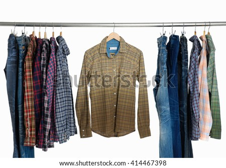 man clothes and jeans of different striped shirt on hangers  - stock photo