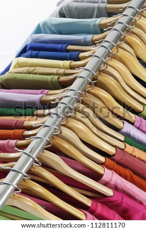 man clothes of different colors shirt on hangers
