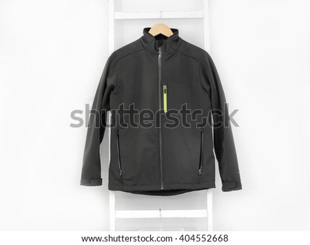 Man clothes on a hanger isolated on a white background - stock photo