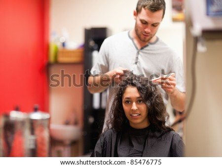 Man combing hair with a comb - stock photo
