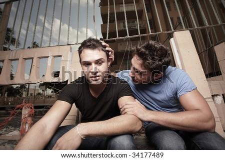 Man comforting his boyfriend - stock photo