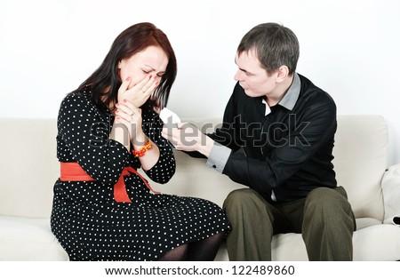 Man comforting his crying woman - stock photo
