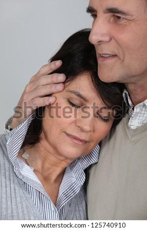 Man comforting his wife - stock photo