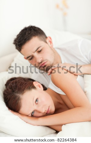 Man comforting his Wife in their bedroom
