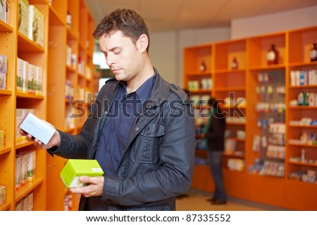 Man comparing two medical products in a pharmacy