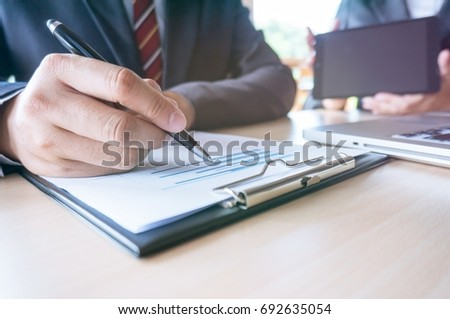 Man Completing Application Form during job interview. human resources concept