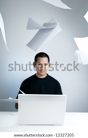 Man concentrate doing his works - stock photo