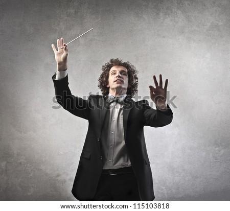 Man conducting an orchestra - stock photo