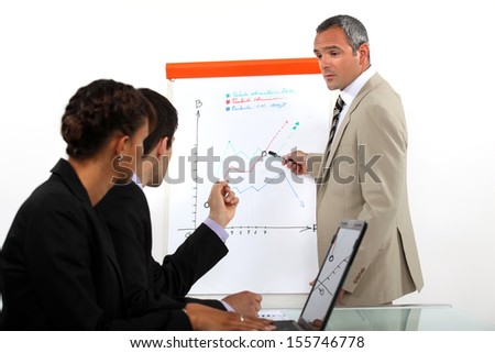 Man conducting business presentation - stock photo