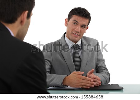 Man conducting interview - stock photo