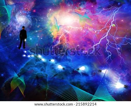 Man considering the expanse of space - stock photo