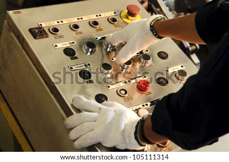 man control buttons machine, Factory operator - stock photo