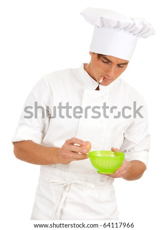 man cook with broken egg above green bowl, isolated on white background