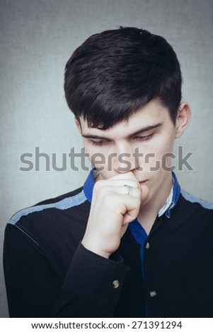 man coughing into a fist - stock photo