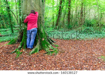 Man counting down for hide and seek played in a forest