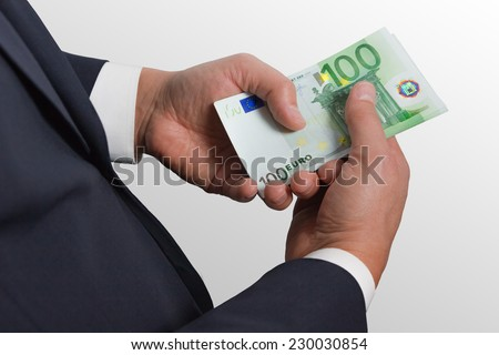 Man counts money euro  isolated on gray background