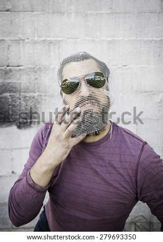 Man covered his face with glasses, fear and fashion - stock photo