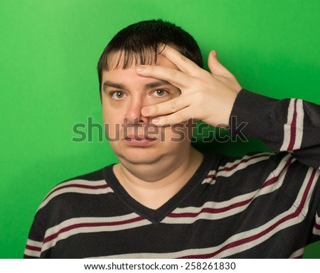 man covered his face with his hand - stock photo