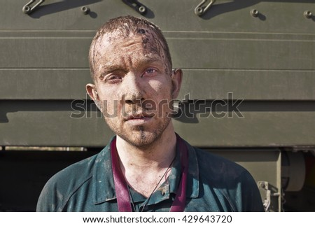 Man covered in mud after strong race