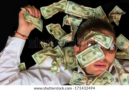 Man covered with US dollars,drowning in debt concept - stock photo