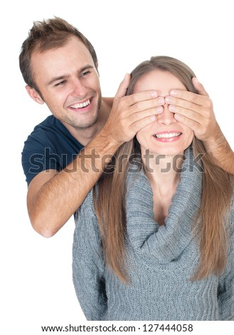 Man covering her lover's eyes before making surprise - stock photo